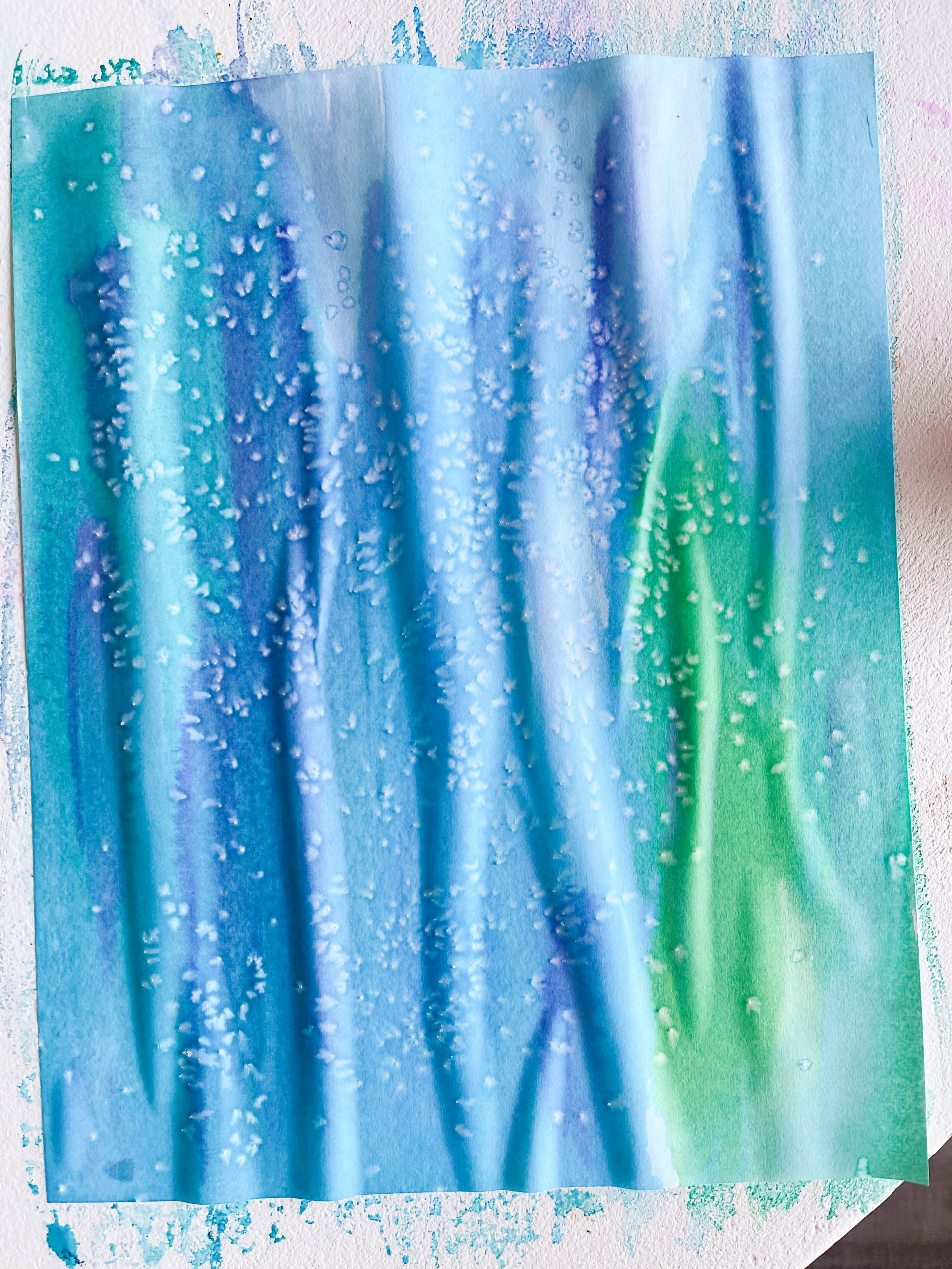 paper painted blue and green with watercolors