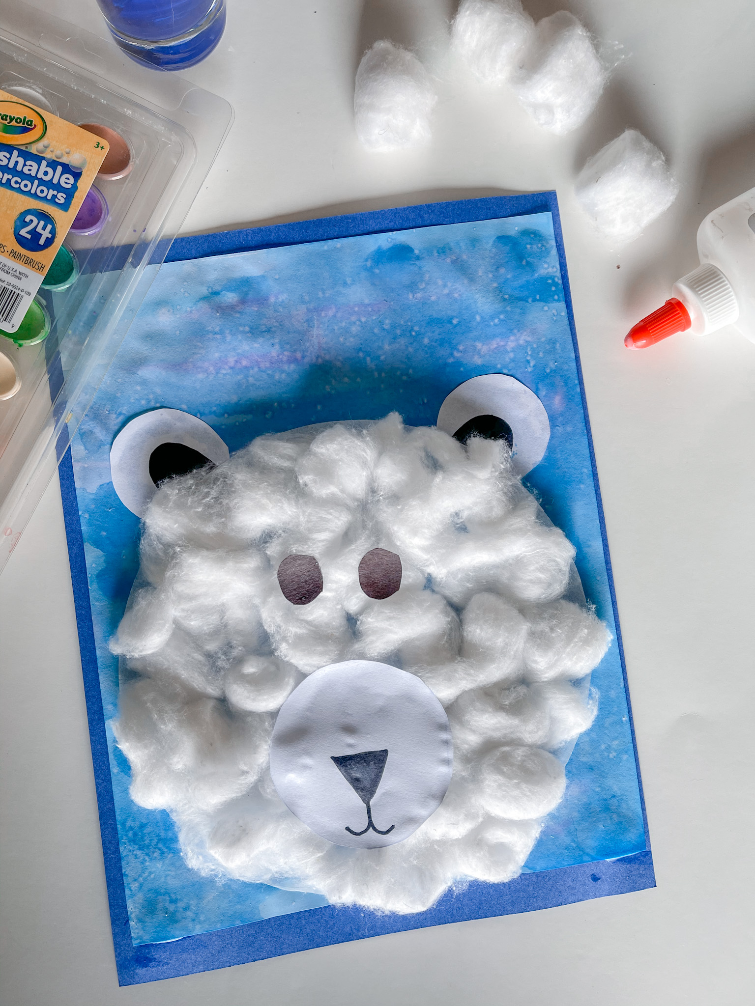 preschool craft, polar bear made of cotton balls with extra supplies in background